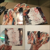 "AUTOGRAPHED ""TATTOOS & TITTIES"" ALBUM (ONLY 200 TOTAL COPIES)"